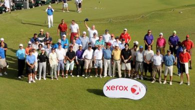 Photo of Pullin and Dunning book Kuwait berth at the Xerox Corporate Golf Challenge's Grand Final